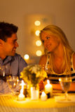 Couple candlelight dinner. Young couple enjoying candlelight dinner in a restaurant stock image