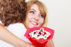 Couple with candy bunch flowers hugging. Love. Stock Images