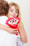 Couple with candy bunch flowers hugging. Love. Stock Photo