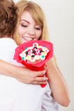 Couple with candy bunch flowers hugging. Love. Royalty Free Stock Photo