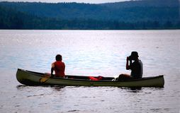Couple in canoe Stock Images