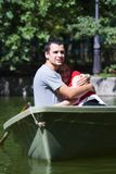 Couple in canoe. Happy young couple embracing in canoe Royalty Free Stock Photography