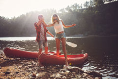 Couple after the canoe ride Royalty Free Stock Photo