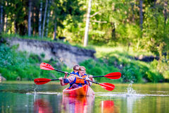 Couple canoe river. Happy men and women canoing on a river Royalty Free Stock Photo
