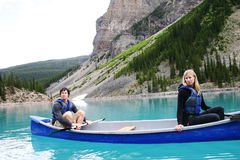 Couple canoeing. Couple disagreeing while canoeing on Moraine Lake Royalty Free Stock Images
