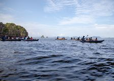 Couple canoeing or kayaking at sea island backdrop. Krabi province, Thailand. Space for text stock images