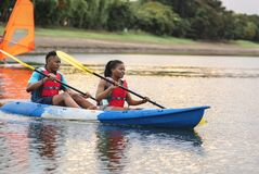 Couple canoeing in a lake royalty free stock photography