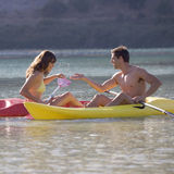 A couple canoeing on a lake Royalty Free Stock Photo