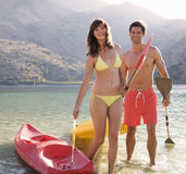 A couple canoeing on a lake Royalty Free Stock Images