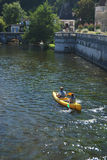 Couple canoeing on river Brantome Stock Photo