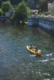 Couple canoeing on river Brantome Stock Photo