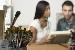 Couple With Canvases In Artist Studio Stock Image