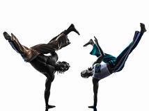 Couple capoeira dancers dancing   silhouette Royalty Free Stock Image