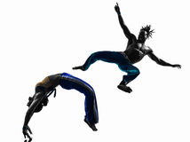 Couple capoeira dancers dancing   silhouette Stock Image