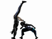 Couple capoeira dancers dancing   silhouette Royalty Free Stock Photo