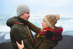 Couple in Caps in Iceland Stock Image