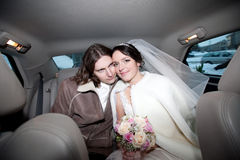 A couple in the car. Wedding stock image