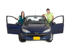 Couple with a car Stock Image