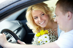 Couple in car. Happy women looking at her boyfriend in the car Royalty Free Stock Images
