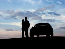 Couple beside the car. (silhouette Stock Image