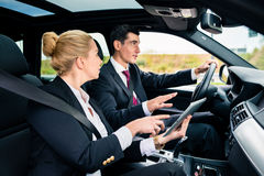 Couple in car being lost navigating with map Stock Photo