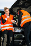 Couple with car breakdown calling towing company Stock Image