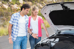 Couple after a car breakdown Royalty Free Stock Image