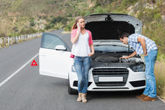 Couple after a car breakdown Stock Photography