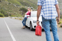 Couple after a car breakdown Stock Photo