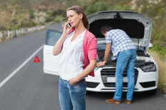 Couple after a car breakdown. At the side of the road Stock Photos