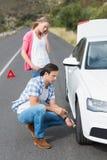 Couple after a car breakdown Stock Photos