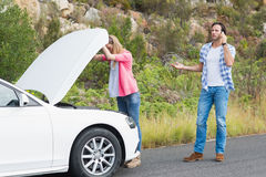Couple after a car breakdown Royalty Free Stock Images
