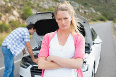Couple after a car breakdown Royalty Free Stock Photography