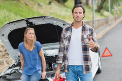 Couple after a car breakdown. At the side of the road Stock Photo