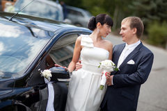 Couple by the car Royalty Free Stock Photos