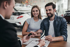 Couple at car dealership royalty free stock photos