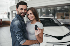 Couple at car dealership stock image