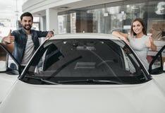 Couple at car dealership stock photo