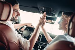 Couple in the car giving high five royalty free stock photo