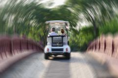 Couple in car going over bridge, blurred image. Romantic appointment, man and woman in car move away over bridge, blurry image stock photography