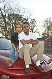 Couple on a Car Royalty Free Stock Photo