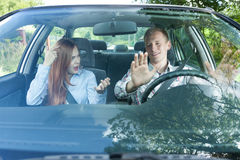 Couple in car having fight. Young couple quarreling while driving a car Royalty Free Stock Photography