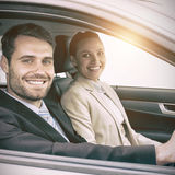Couple in a car looking at the camera Royalty Free Stock Images