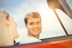Couple in a car looking to each other Royalty Free Stock Photo