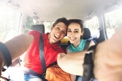 The couple in the car makes selfie royalty free stock photos