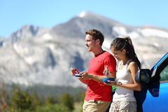 Couple on car road trip travel in Yosemite eating Royalty Free Stock Photos