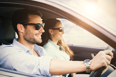 Couple in a car smiling Royalty Free Stock Photography
