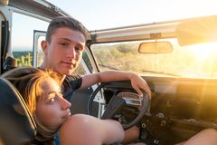 Couple in a car at sunset Stock Photo