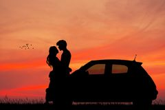 Couple in the car at sunset kisses. Illustration of couple in the car at sunset kisses Royalty Free Stock Photos