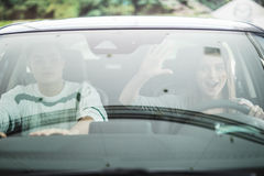 Couple in a car about to have a crash. Woman drive a car. Stock Photography